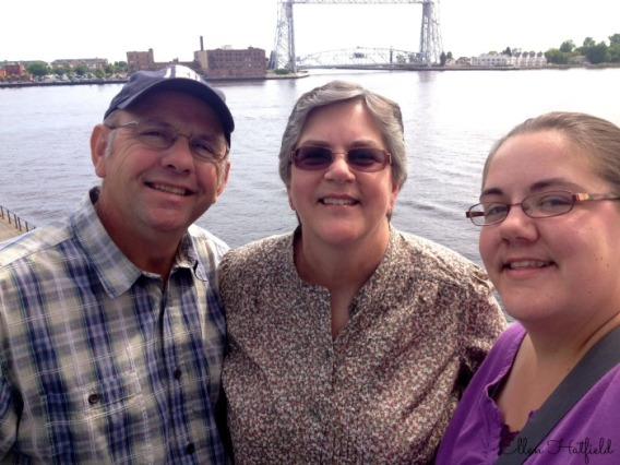 Dad, Mom, and I with the harbor in Duluth behind us.