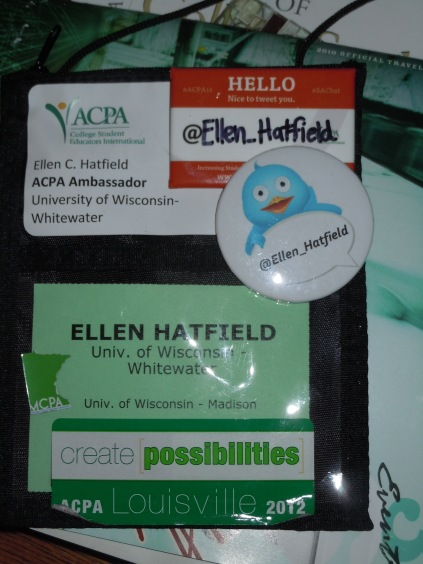 My name badge with some flair. I loved the Twitter buttons best!